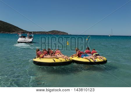 Kids Towed Together In A Watersport Buoy