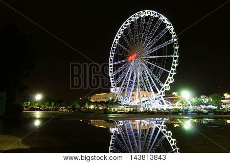 BANGKOK, THAILAND - August 20,2016 : Ferris wheel at Asiatique the riverfront in the night on August 20,2016 in Bangkok. Here is the night market in Bangkok - Thailand.