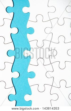 Pieces of puzzle connected together on blue background. And some of them are without connecton. Buseness team concept.