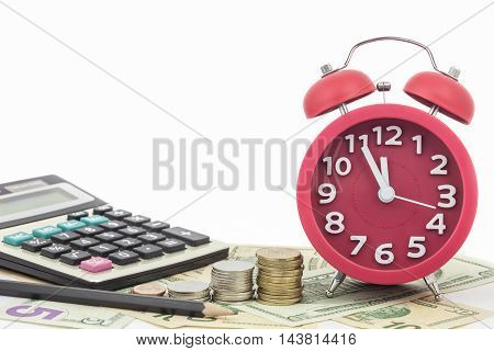 Red alarm clock and Calculator on money banknotes Euro and Dollars concept of business planning and finance and savings deadline
