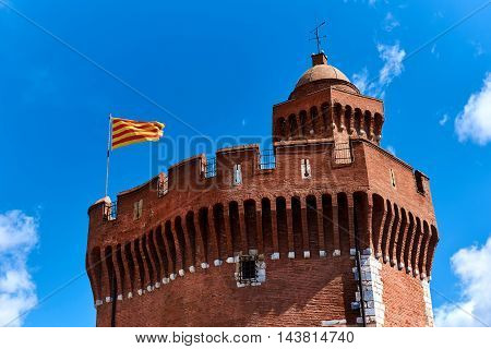 The Castillet against blue sky is a small fortress built in the 14th century. Perpignan France