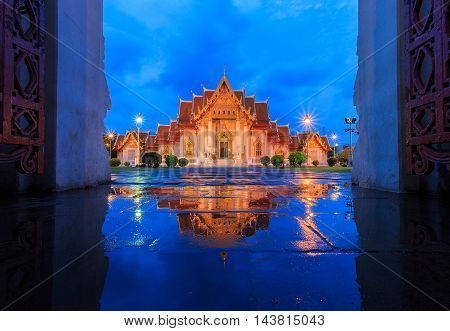 Wat Benchamabophit in Bangkok at twilight with reflection in the water