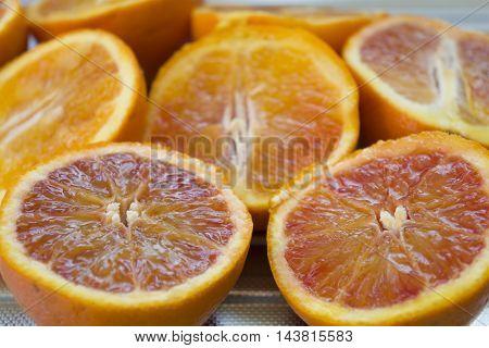 fresh red oranges cut half ready to prepare a juice