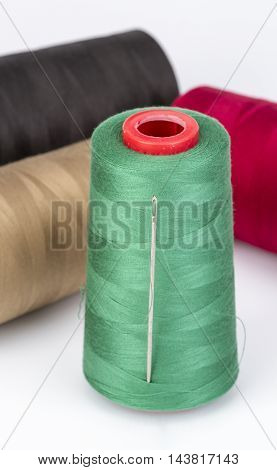 Sewing Threads And Needle On White Background