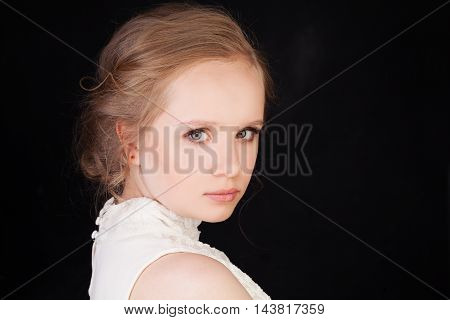 Young Face. Cute Girl with Blonde Hair on Black Background