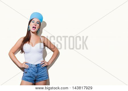 Young funny sexy girl laughing posing on white background