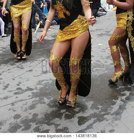 Cajamarca Peru - February 7 2016: Costumed women's legs march in Carnival parade in Cajamarca Peru on February 7 2016