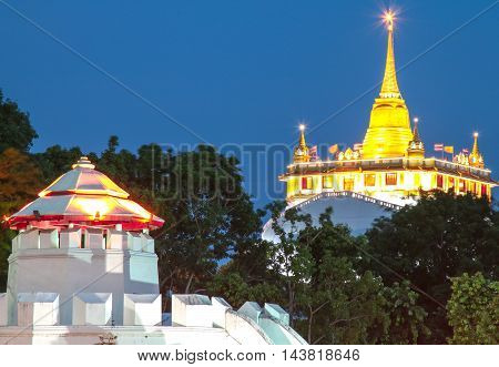 Pom Maha Kan and Golden Mount Temple in Bangkok at dusk (Wat Sraket), Thailand
