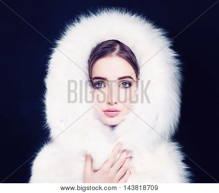 Pretty Woman in White Winter Fur on black