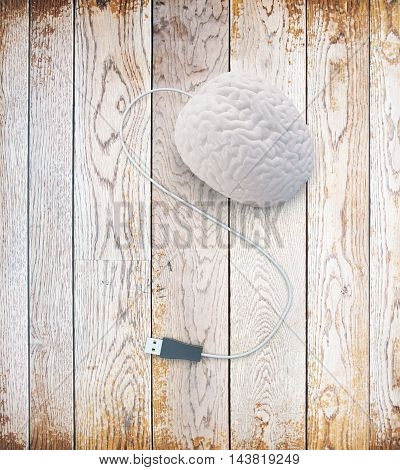 Brainstorming concept with abstract human brain usb plug on aged wooden surface. 3D Rendering