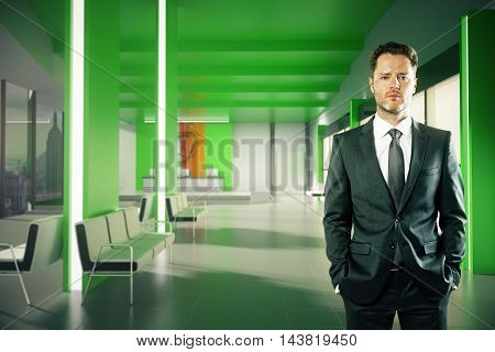 Confident Businessman In Green Lobby