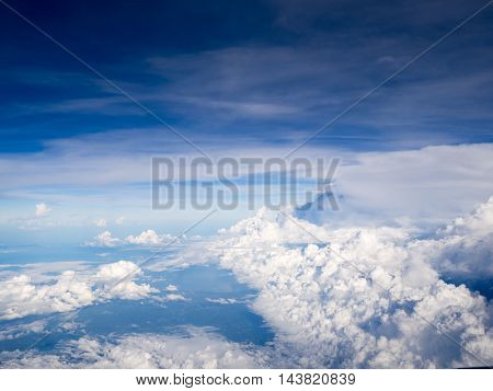Cool soft unique white cloud and blue sky view from window of airplane while flying over Thailand.