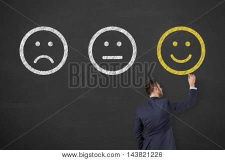 Happy Drawing on Chalkboard Background Working Businessman Conceptual