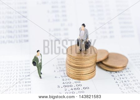 Business concept with miniature people workers on money coin piles. business finance concept