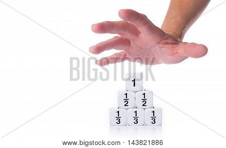 Male hand reaching out for white fraction dices showing third half and full numbers on white background with room for copy space