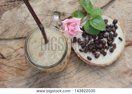 Iced coffee is delicious on wood background
