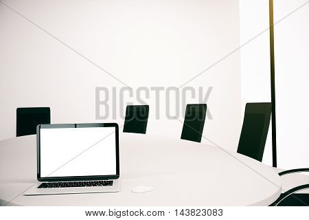 Conference table with blank white laptop computer. Mock up 3D Rendering