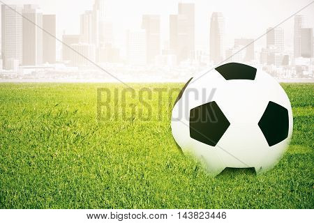 Closeup of football on grass. Abstract city background. 3D Rendering