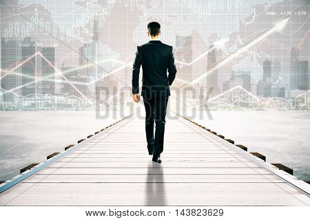 Businessman walking on wooden pier. City with forex chart and sunlight in the background. Financial growth concept
