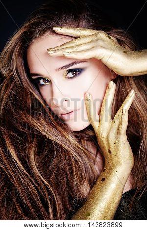 Sensual Beauty. Beautiful Model with Golden Makeup