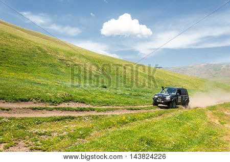 Editorial. Assy plateau. Tien Shan. Kazakhstan. 15.06 2014 . Country road. Rally organized in the mountains.