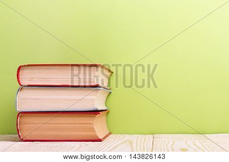 Open book on green wooden background. Education concept. Copy space for ad.