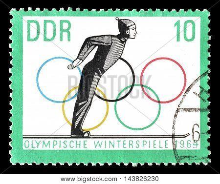 GERMAN DEMOCRATIC REPUBLIC - CIRCA 1963 : Cancelled postage stamp printed by German Democratic Republic, that shows skier.