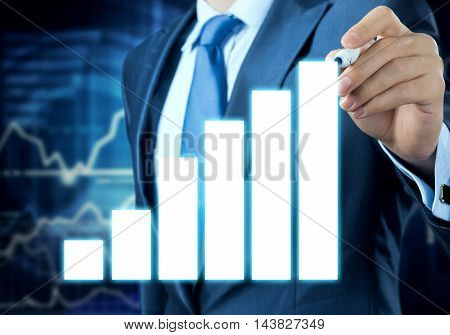 Close view of businessman drawing on screen growing graph