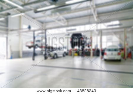 Blurred defocused background of car service and repair centre.