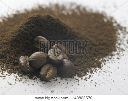 coffee beans and ground isolated on white background