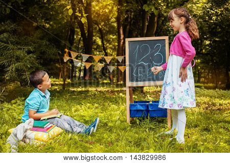 little girl playing with a boy at school