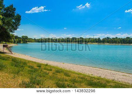 Beach on beautiful Jarun lake in Zagreb, Croatia, sunny summer day