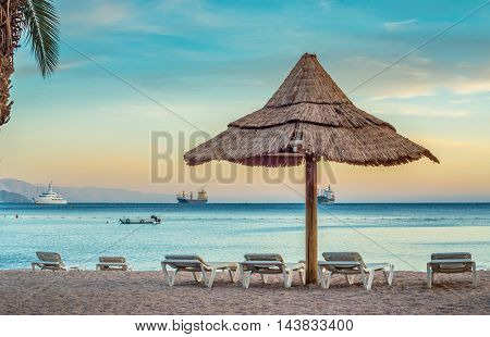 Relaxing atmosphere on the public beach of Eilat - famous resort city in Israel