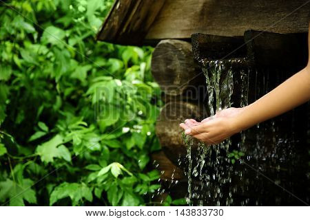 Woman pouring water in hands