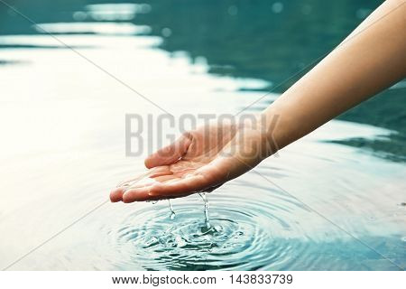 Woman pouring water in hand