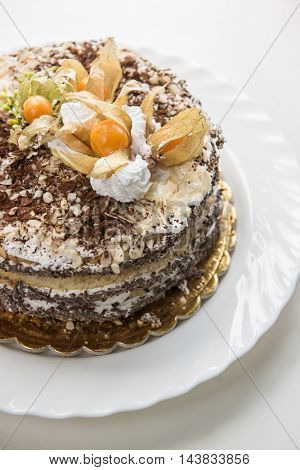 Chocolate cake with walnuts and physalis