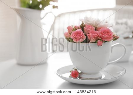 Flower bouquet of rose and chrysanthemum in cup on table