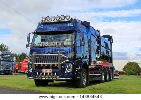 ALAHARMA, FINLAND - AUGUST 12, 2016: Blue Volvo FMX Vacuum truck of Sjobloms Tankservice Kb customized with chrome accessories and airbrush paintings on display on Power Truck Show 2016 in Alaharma Finland.