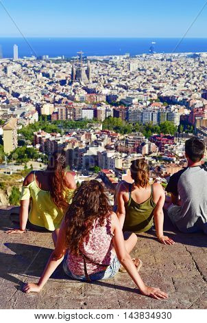 BARCELONA, SPAIN - AUGUST 18: People observing the city from above on August 18, 2016 in Barcelona, Spain. From the top of the hill, there is a wonderful view of the city