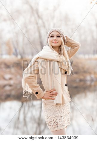 happy blond woman walking  in the autumn park