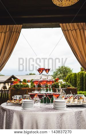 Pyramid of glasses with wine on the table