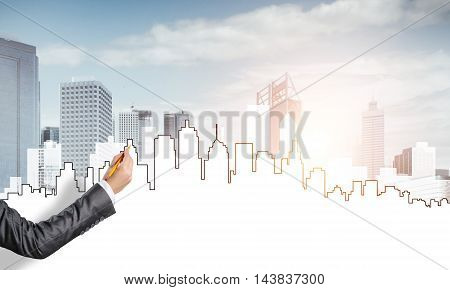 Hand of woman designer drawing with pencil construction project