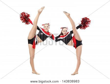 Two professional cheerleaders posing at studio. Vertical split. Isolated over white.