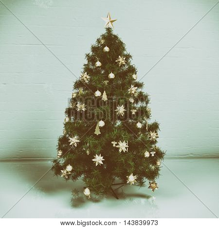 Christmas tree with decorations on light background. Retro  effect