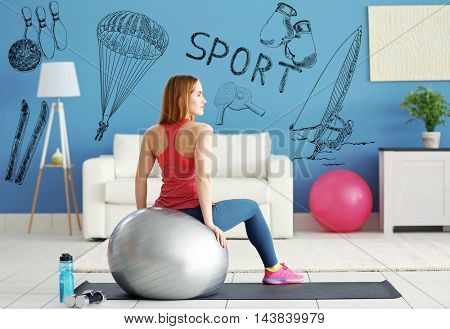 Beautiful young woman doing exercise with fit ball on mat at home. Sport lifestyle concept. Diversity of sport icons on background.
