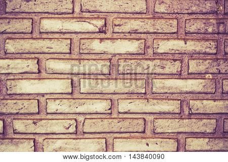 Weathered stained old brick wall background close up
