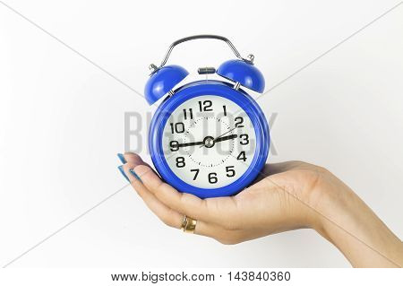 Alarm Clock In Woman Hand Isolated On White Background