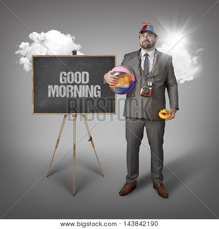 Good morning text with holiday gear businessman and blackboard with text