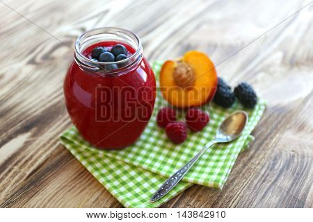 Fresh fruit and berry cocktail on wooden background