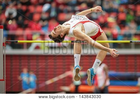 LINZ, AUSTRIA - FEBRUARY 6, 2015: Rory Dwyer (#411 Great Britain) competes in the men's high jump event in an indoor track and field event.